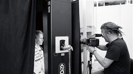 Photographer Martin Schoeller (right) takes photos of Brandon Hartley (left)