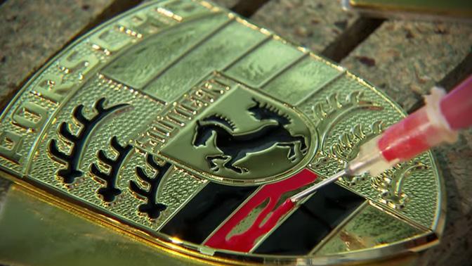 Manufacturing an unmistakable trademark: the Porsche Crest